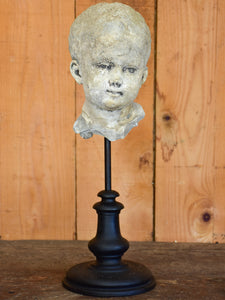 Salvaged mounted antique sculpture