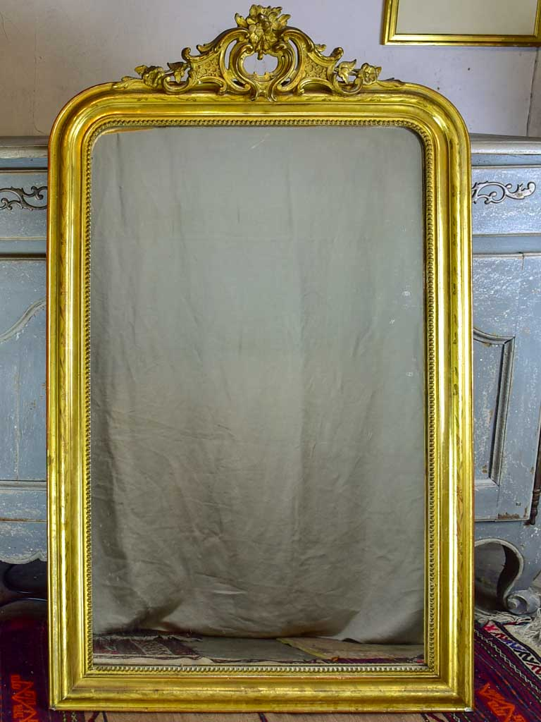 "Antique French Louis Philippe mirror with gilded frame and crest 30"" x 49¼"""