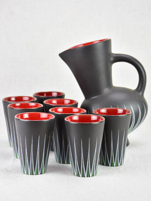 Andre Baud Vallauris set of eight cups and tilted pitcher - black white red and green