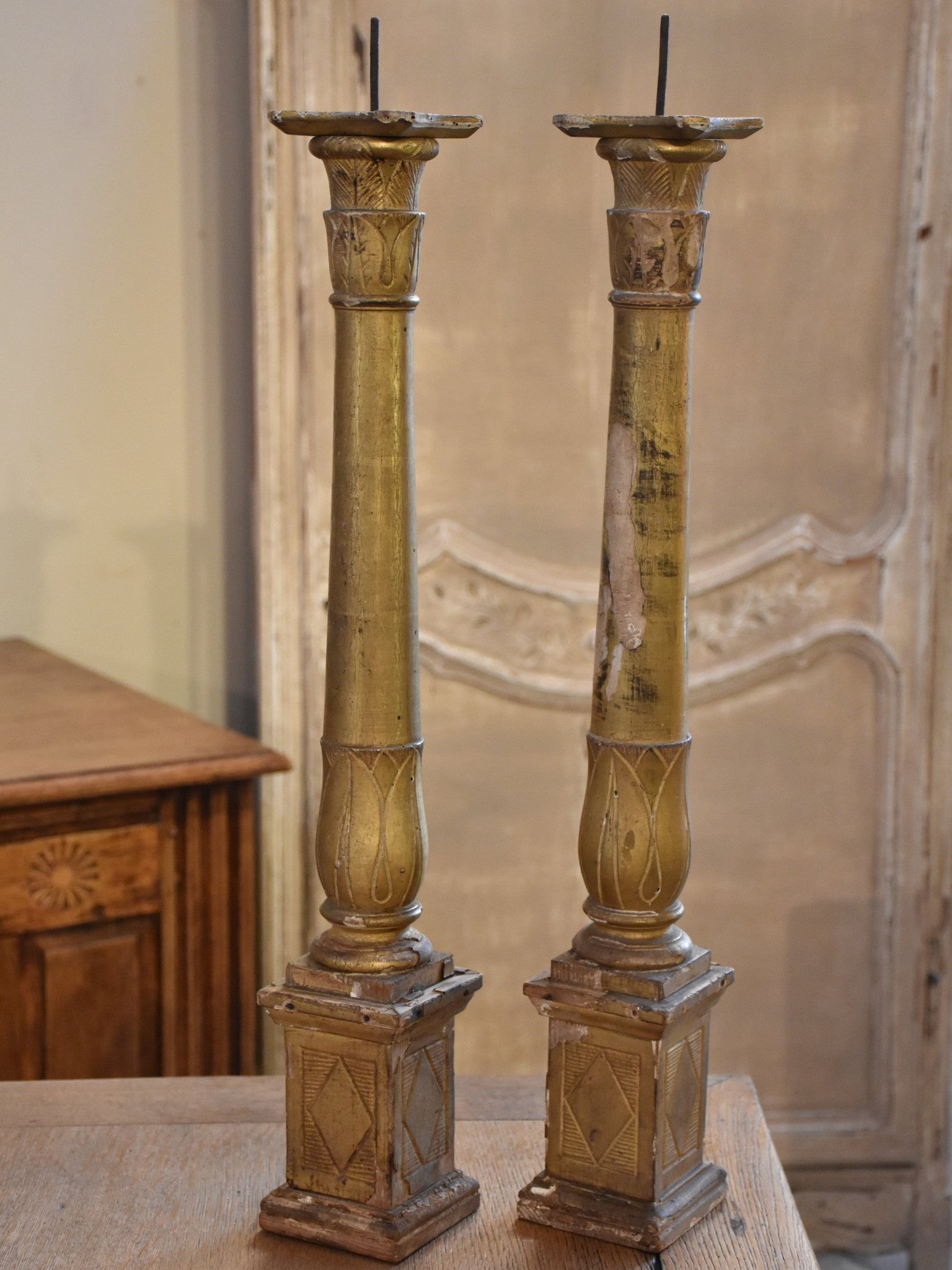 Pair of late 18th century French giltwood candlesticks