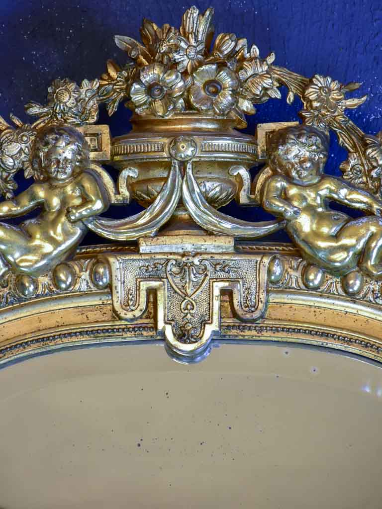 "Gilded large Napoleon III mirror with elaborate crest and beveled glass 35½"" x 70¾"""