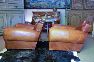 Pair of 1950's moustache back leather club chairs