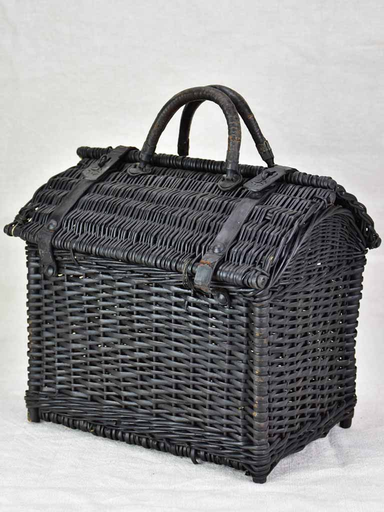 Black wicker lunch basket with two handles