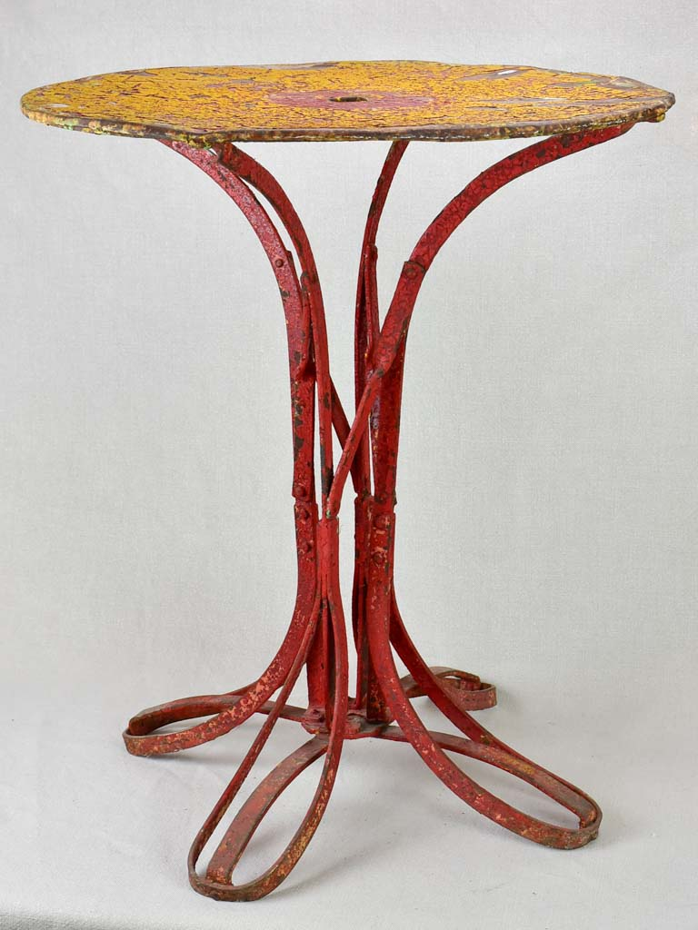 Early twentieth century bistro garden table with yellow and red patina