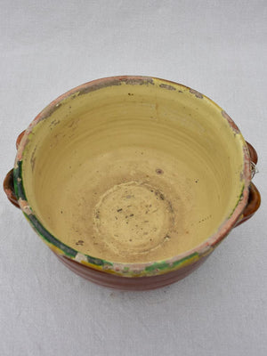 Large antique French casserole bowl with brown and yellow glaze and double handles 8""