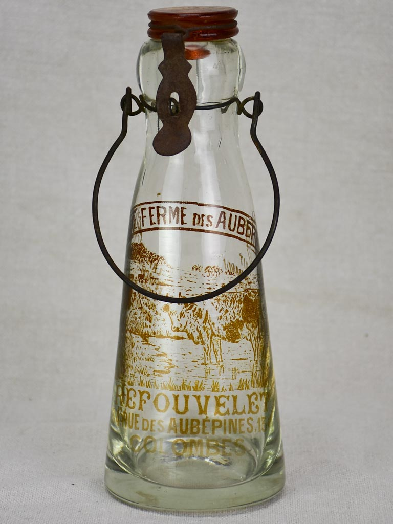 Antique French glass milk bottle with brown decoration
