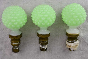 Three 18th century milk glass balustrade balls