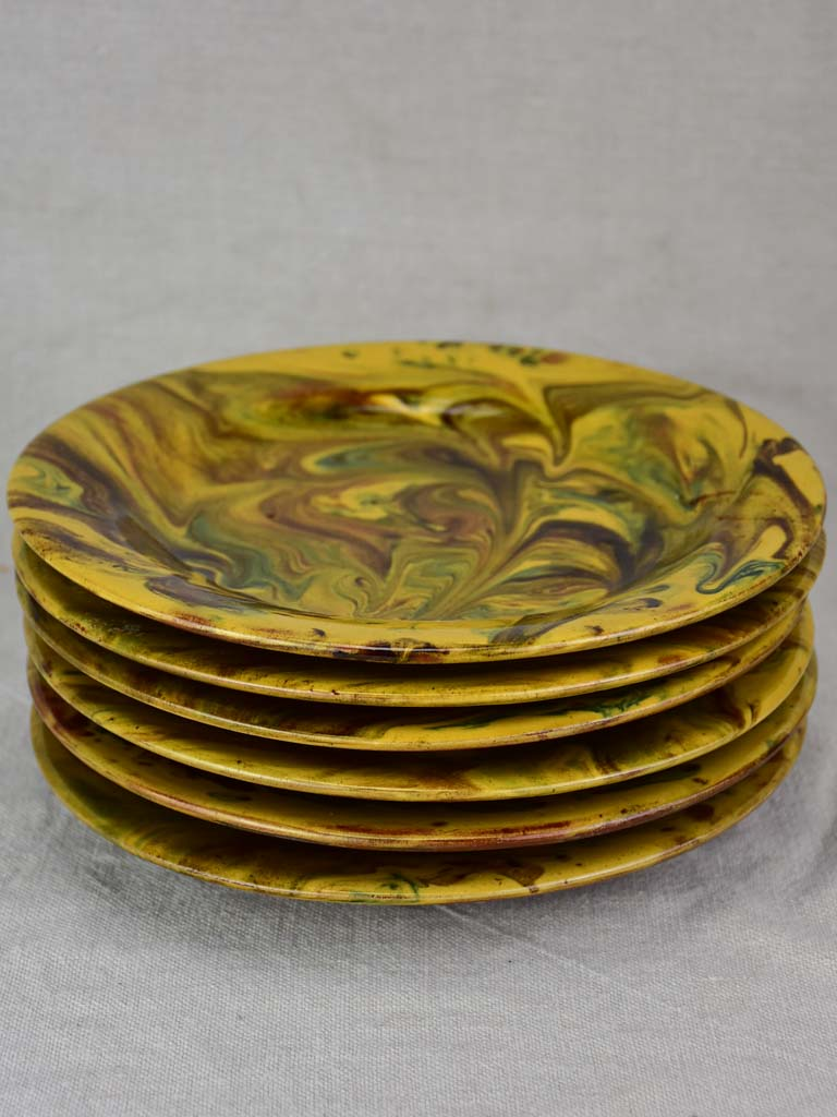Six terracotta plates with green and yellow glaze 9½""