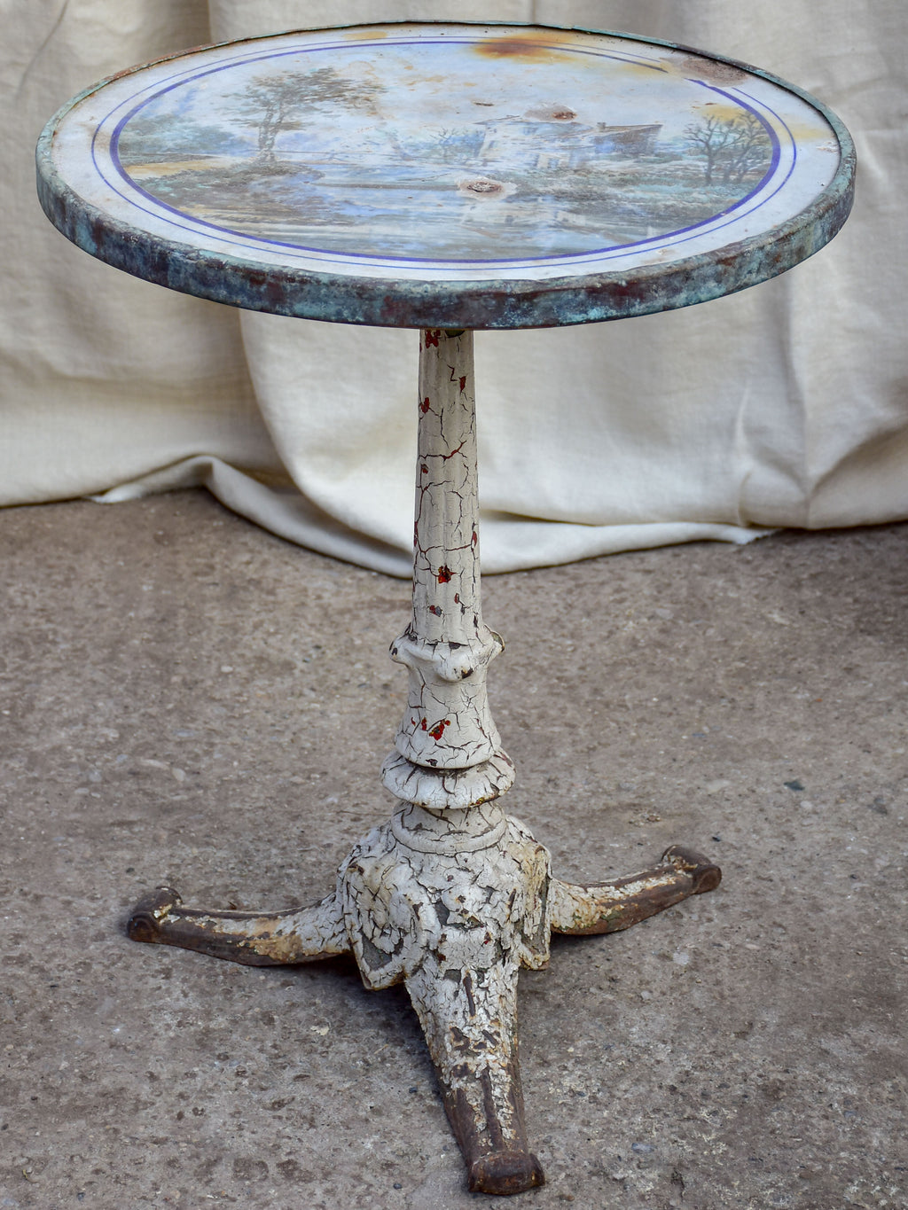 Antique French bistro table with decorative top