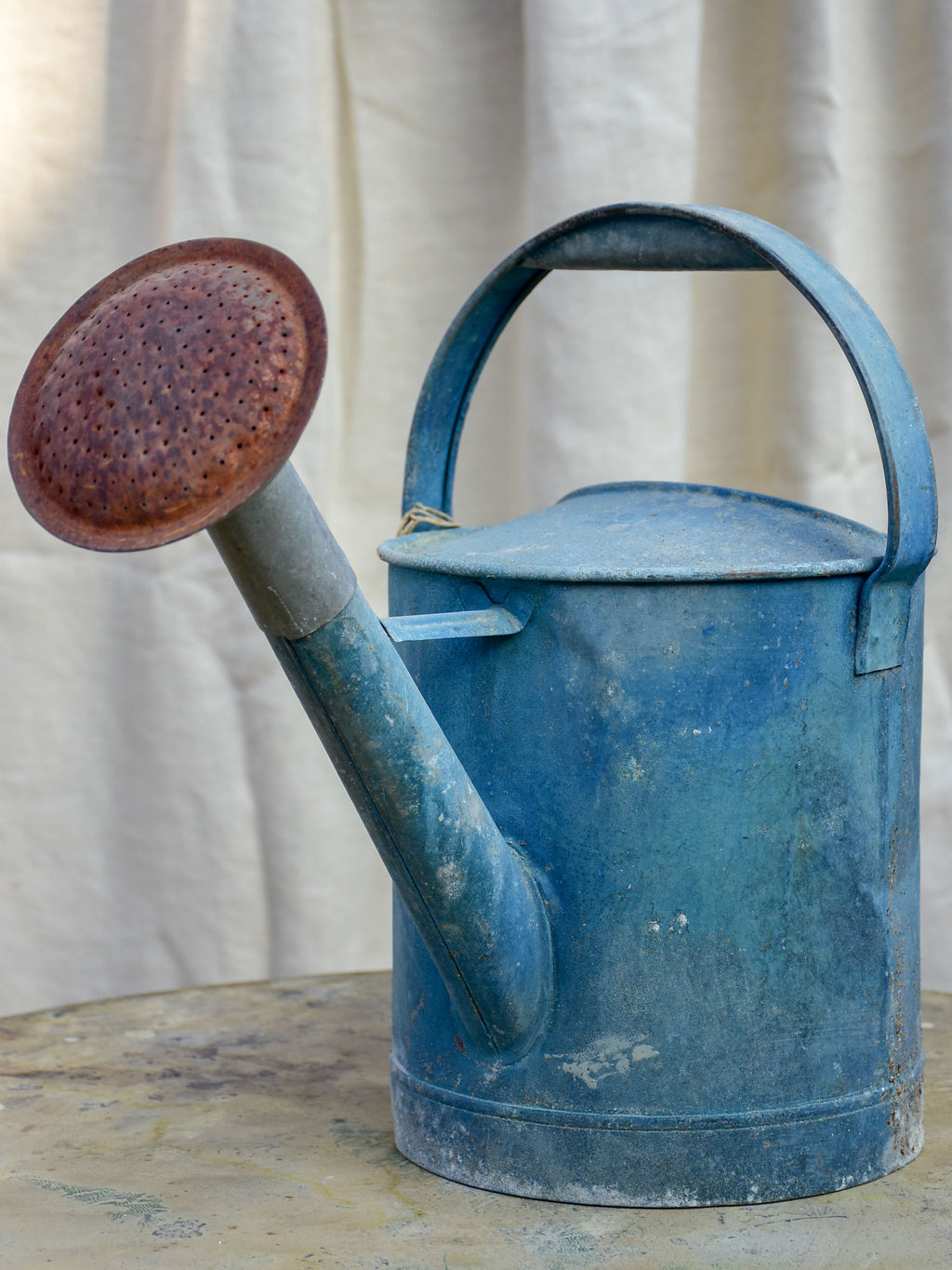 Antique French watering can with blue patina