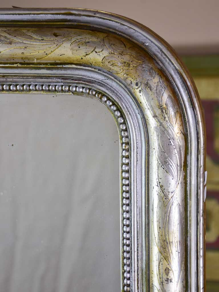 "19th century Louis Philippe mirror with silver leaf frame and running pearl 26¾"" x 41"""