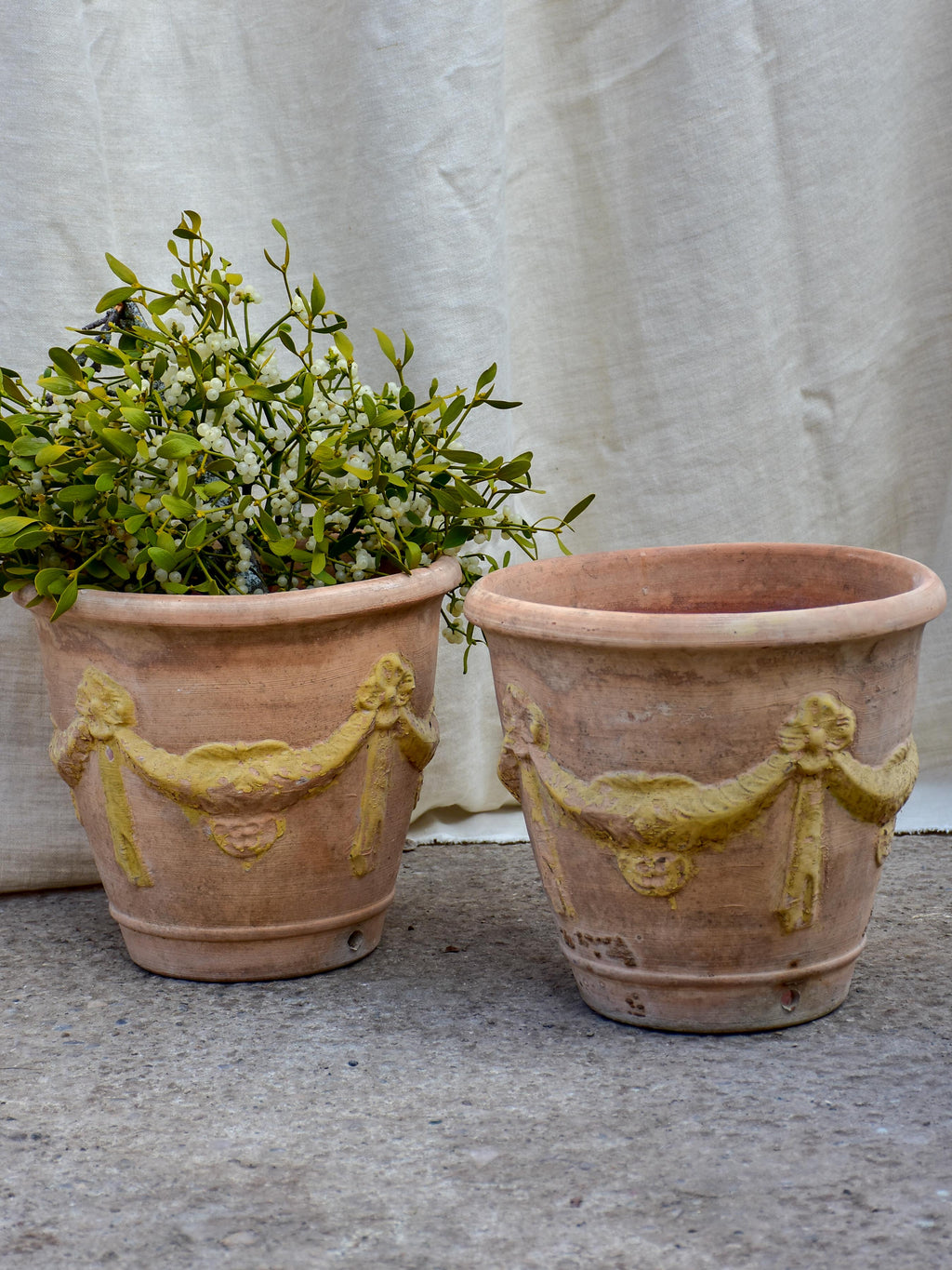 Pair of vintage terracotta garden planters with garlands