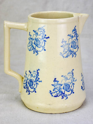 Antique Saint-Uze pitcher with blue flowers