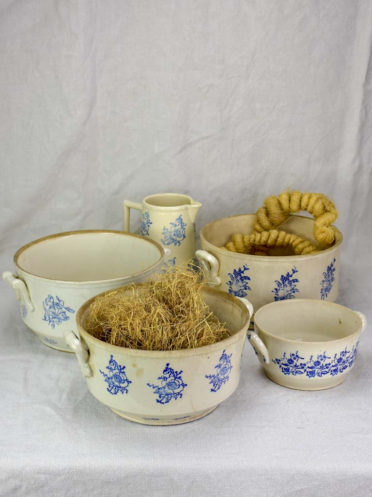 Collection of antique French Saint-Uze soup tureens and pitcher