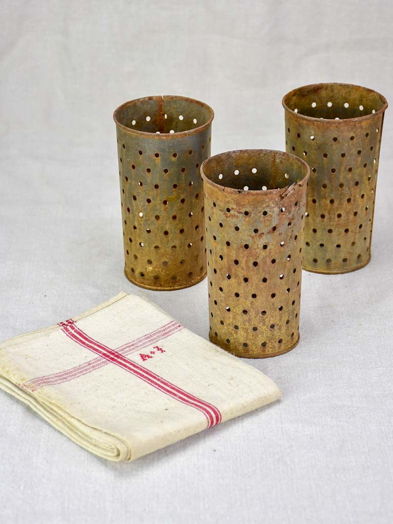 Collection of three tin cheese molds / faisselles