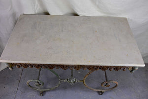 19th Century French butcher's table with marble top and wheels