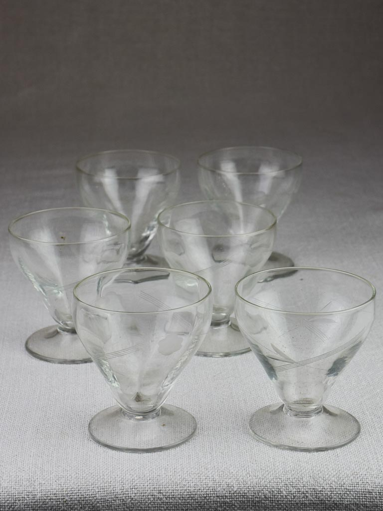 Six 1950's aperitif glasses with etched flowers