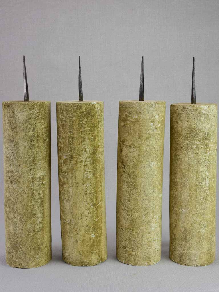 Four large stone candlesticks 16½""