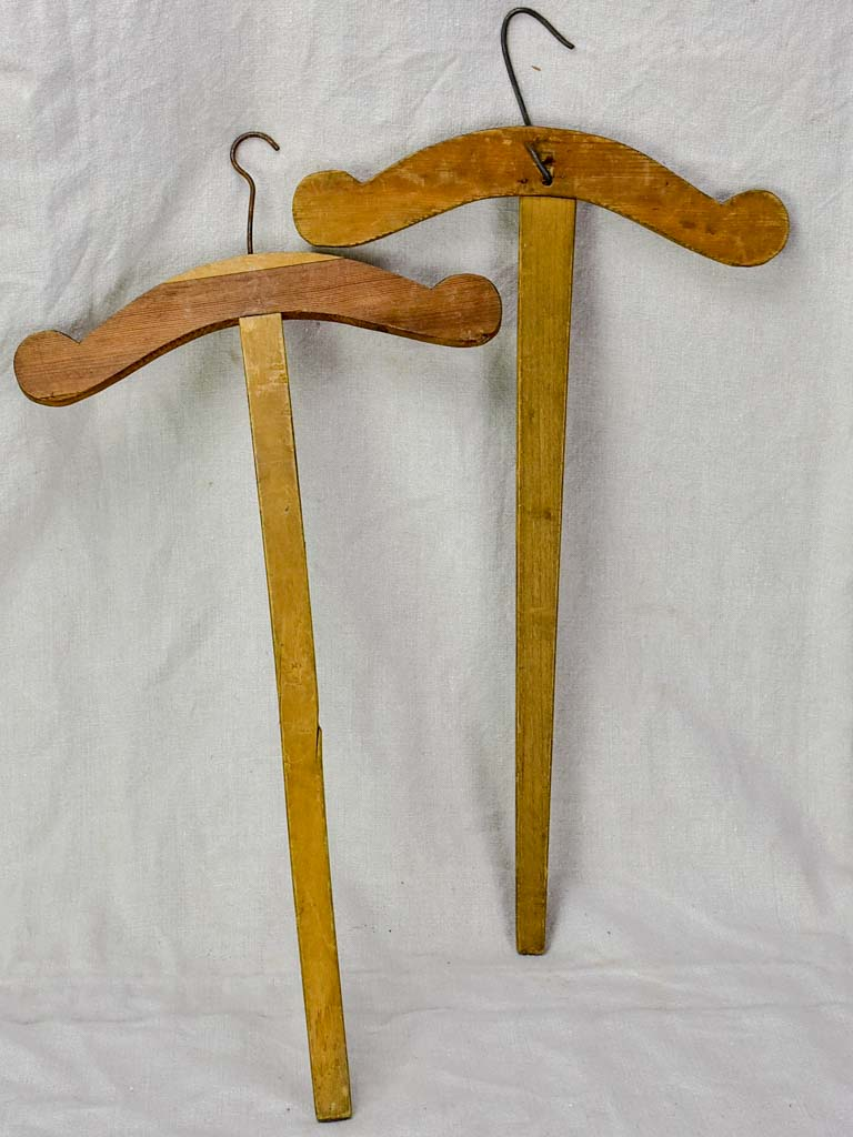 Two antique French coat hangers