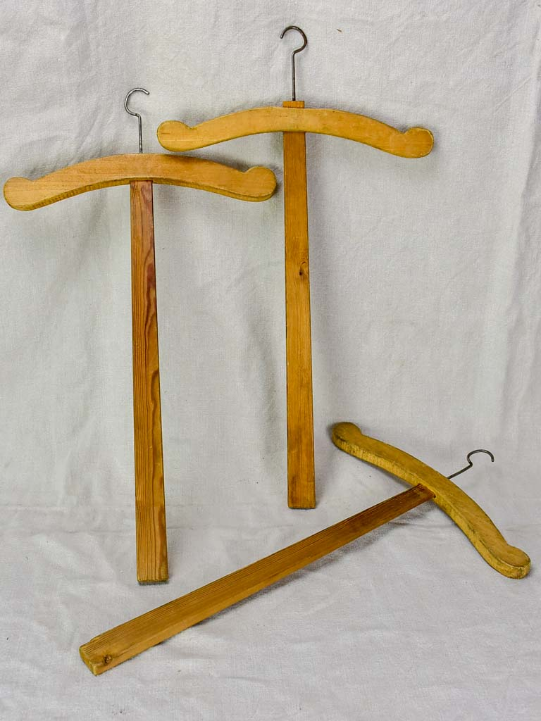 Three antique French coat hangers