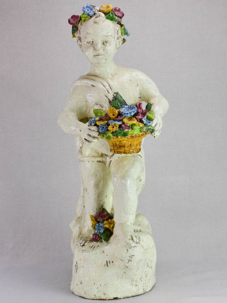 Mid century faience Putto with colorful flowers 26""