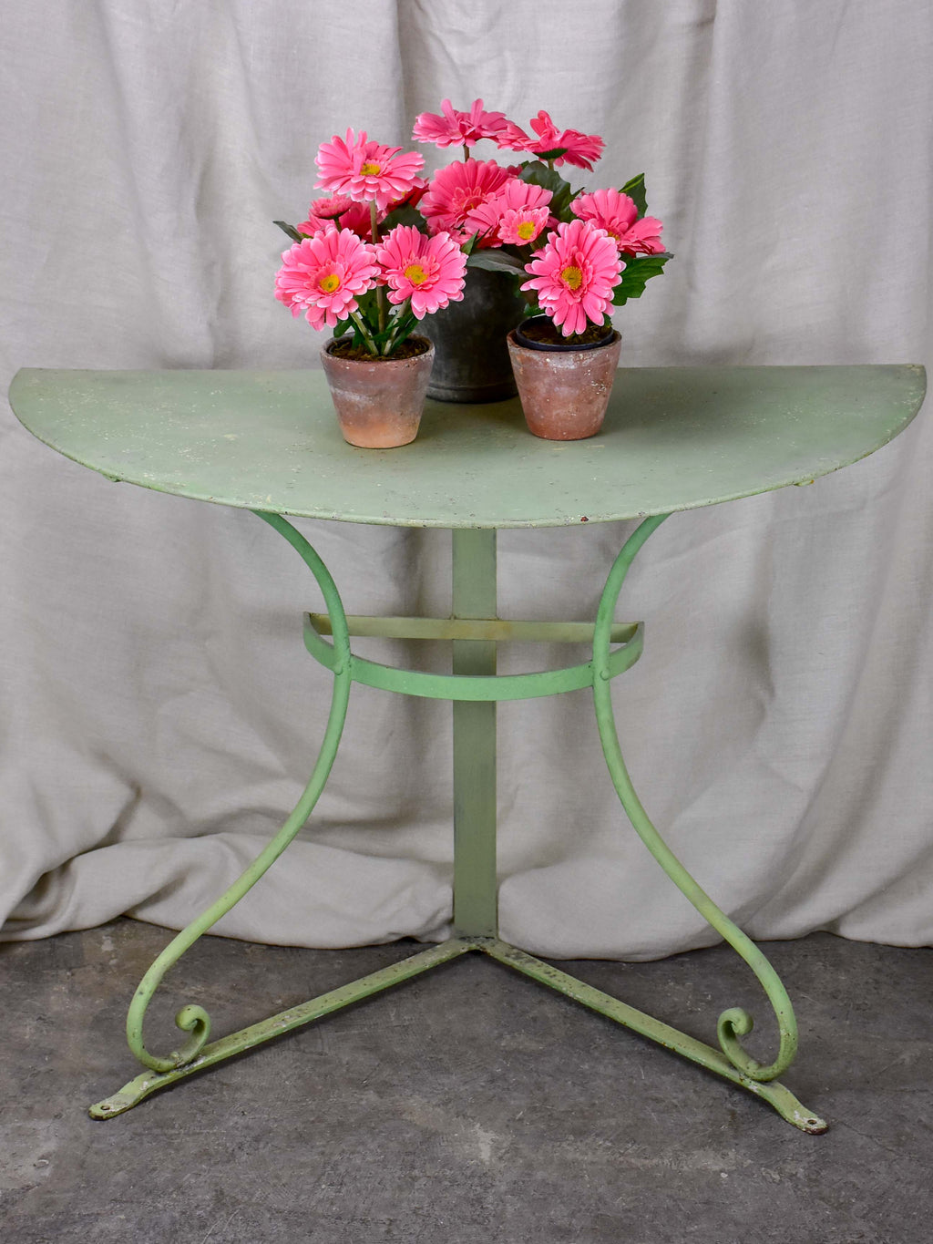 Pair of antique French half-moon garden tables