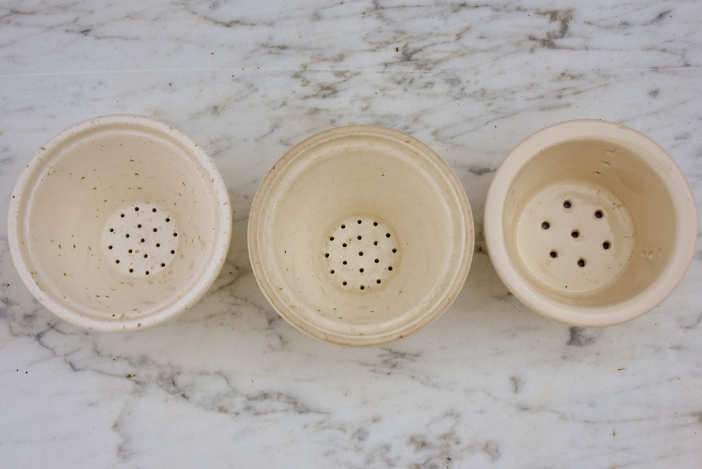 Three white miniature French faience cheese molds