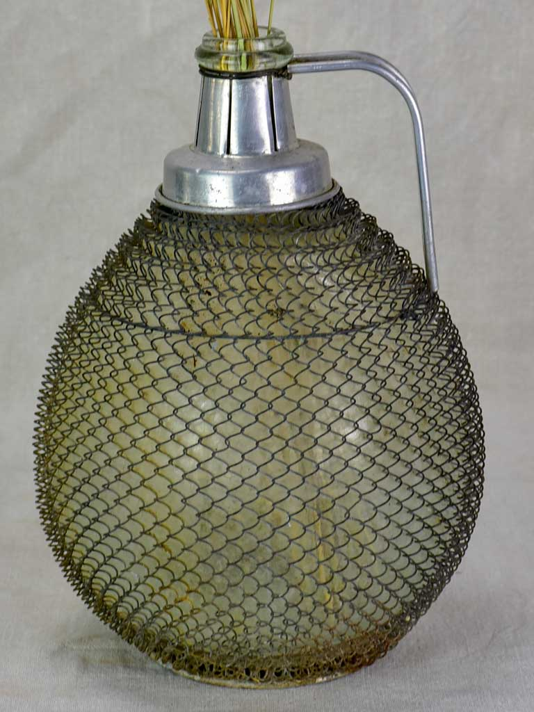 Mid century wine demijohn in mesh from Savoy 9""""