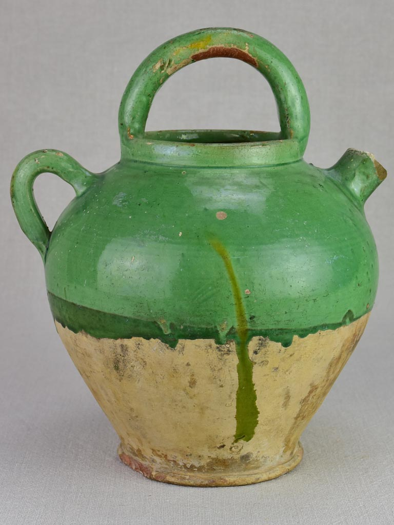 Early twentieth century French water pitcher with green glaze 11½""