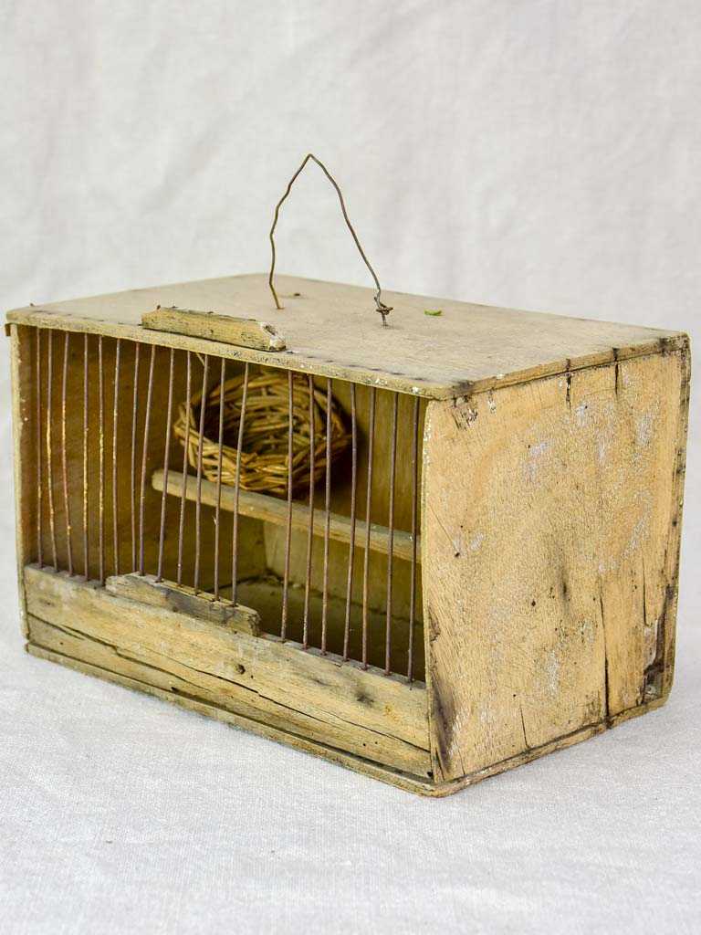 Small 1920's birdcage with nest and water
