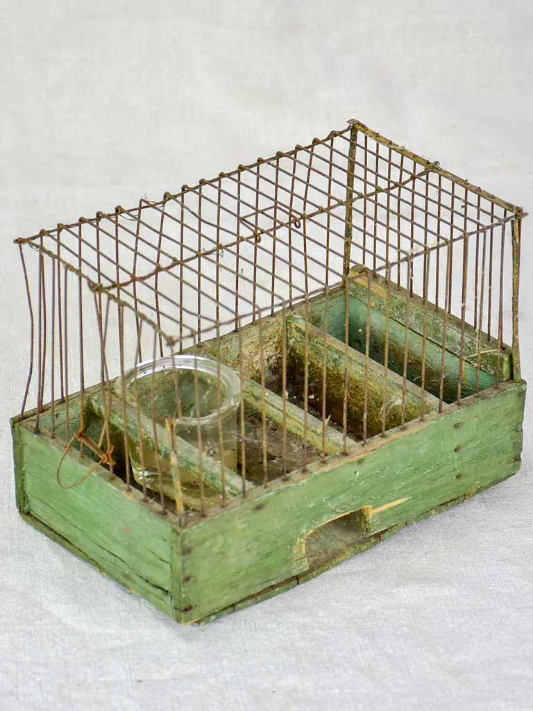 Early 20th century French birdcage with green patina