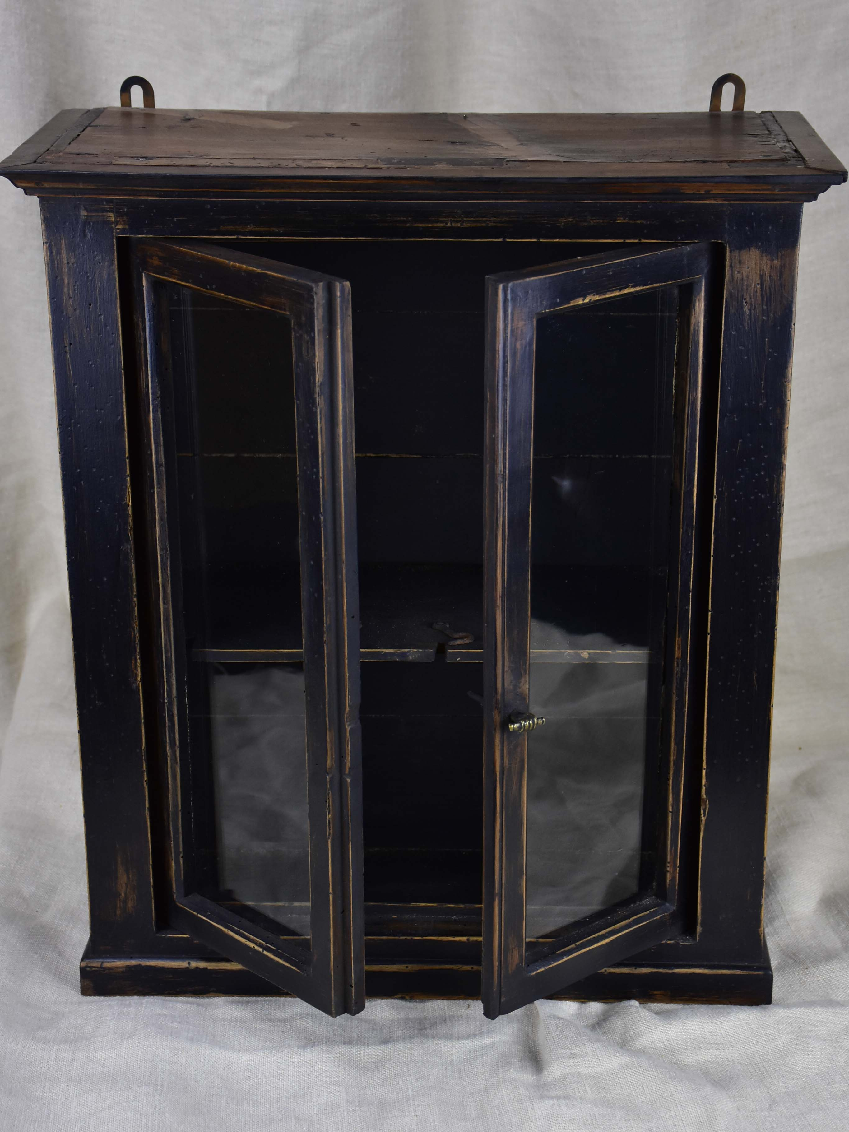Small late 19th Century French glass door cabinet