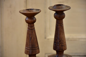 Pair of antique olivewood candlesticks