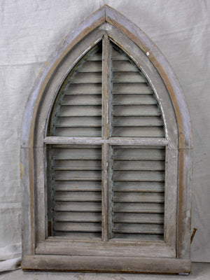 Antique French window with shutters - peaked arch