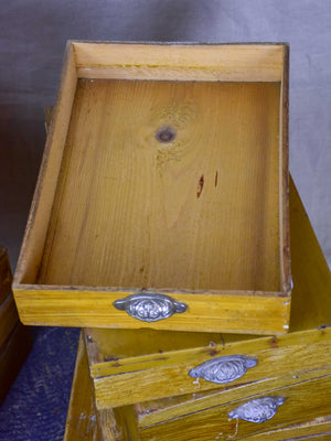 Set of twelve antique French boxes from a glove shop