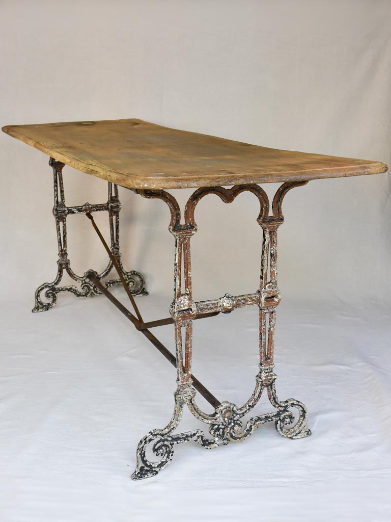 Early twentieth century French bistro table with cast iron base and timber top 66¼""