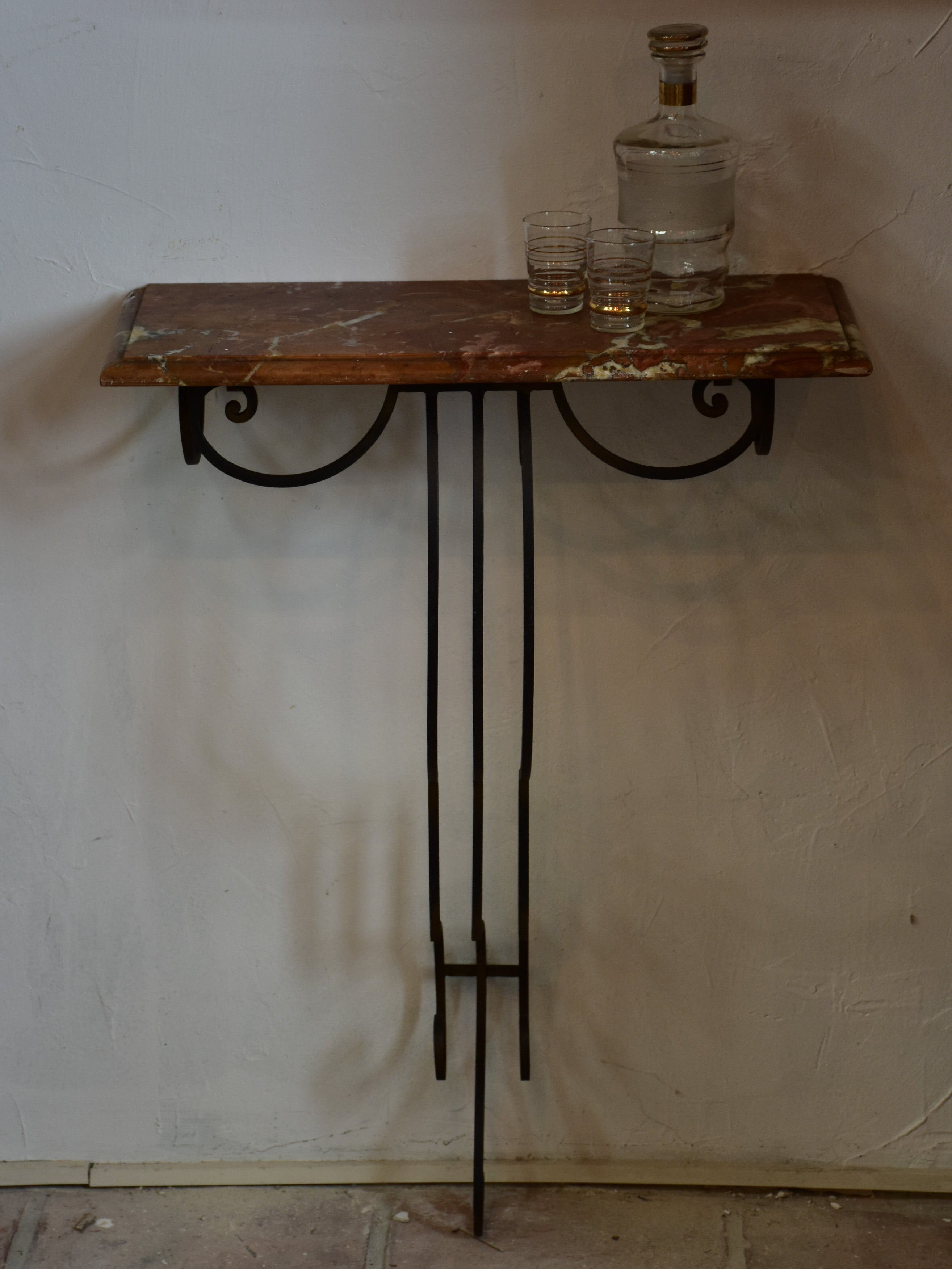 Small marble top console table with decorative wrought iron base