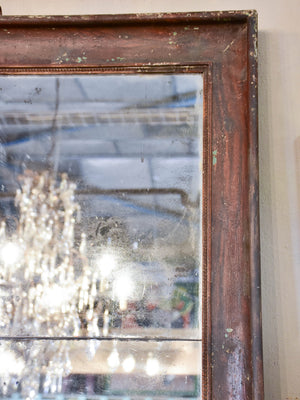 Large antique French two-piece mirror with dark frame