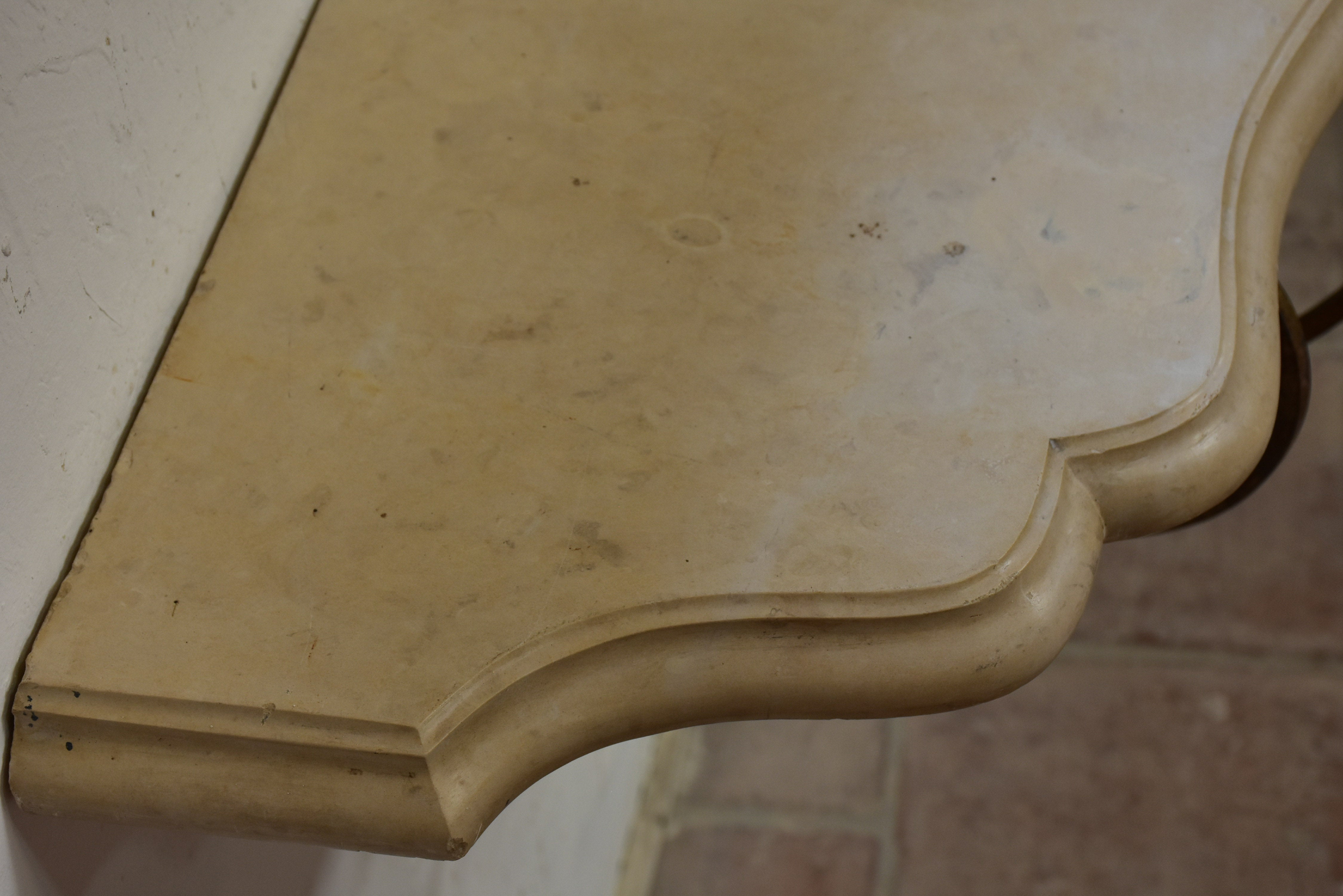 Floating console table with cream marble top and decorative iron base