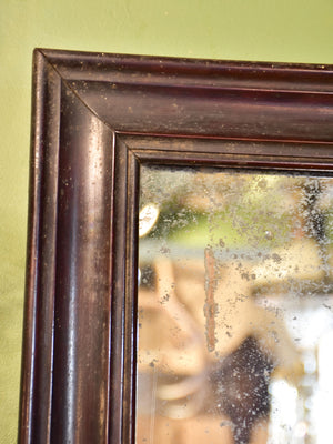 Late 19th century French mirror with black frame