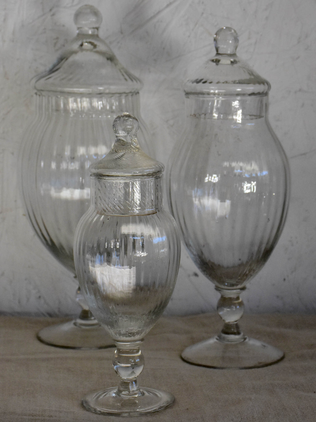 Three vintage French glass vanity jars with lids