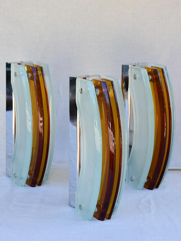 Set of three amber and pale blue glass wall sconces from the 1970's 13""