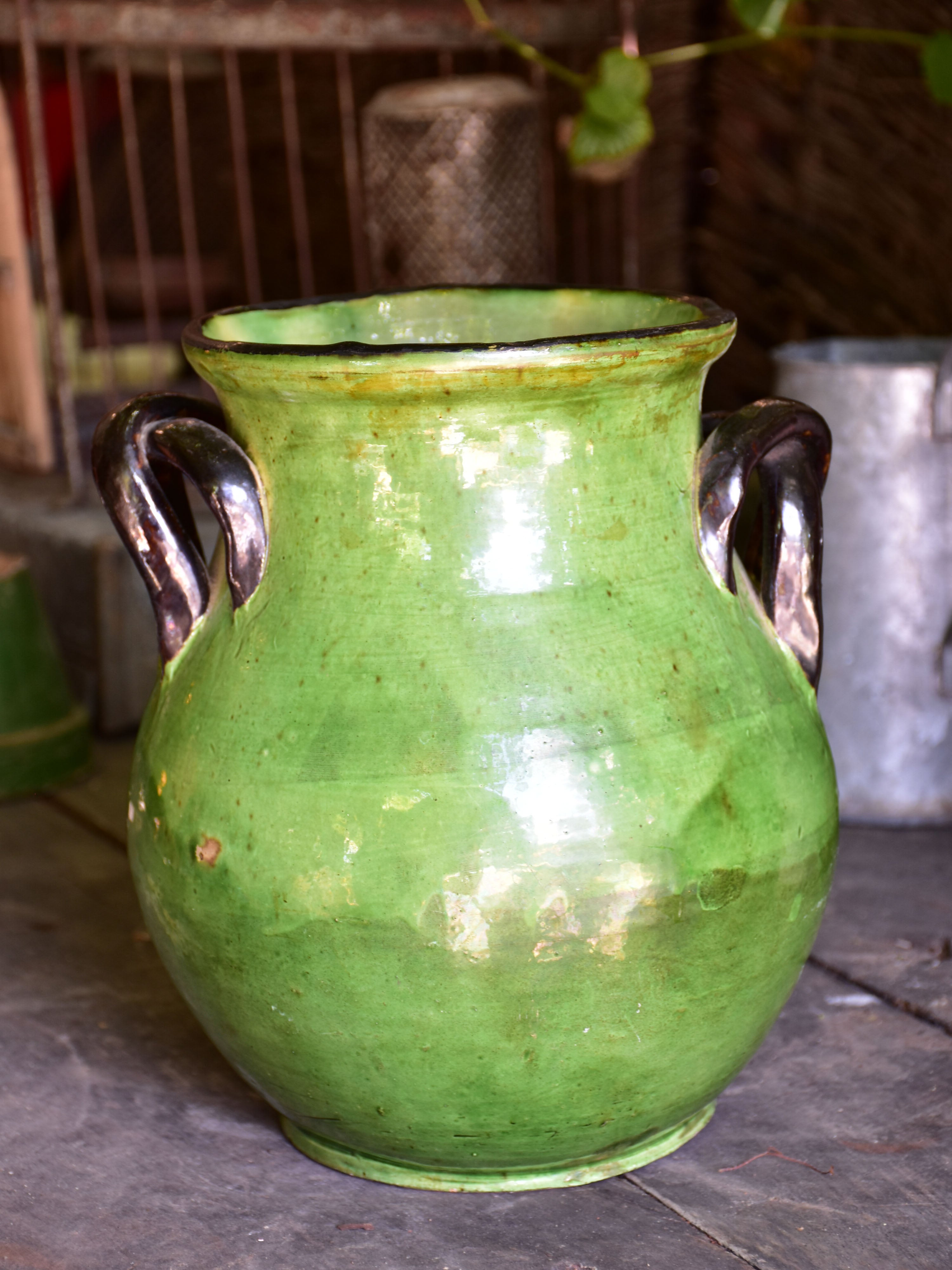 Rare green glazed vase with pretty black handles from the Ardeche