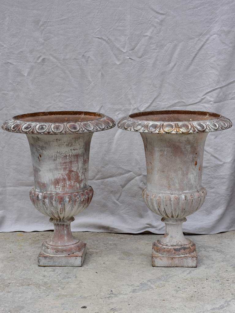 Pair of large 19th Century cast iron Medici urns 26½""