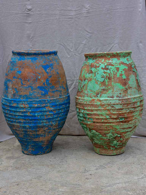 Two very large antique Spanish olive oil jars - blue and green