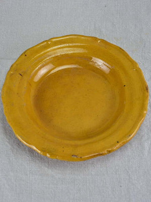 Set of seven mid century bowls with orange glaze 9½""