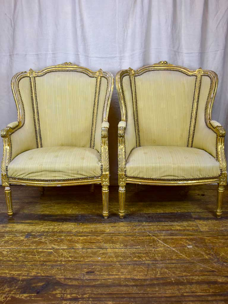 Pair of antique Louis XVI gilded armchairs