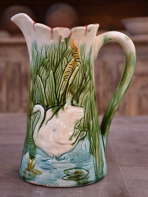 Antique Barbotine Majolica jug with bathing swans