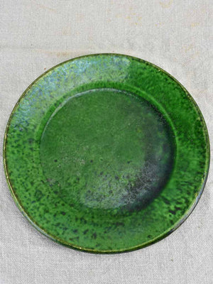 Collection of three early twentieth century green bowls and one green plate