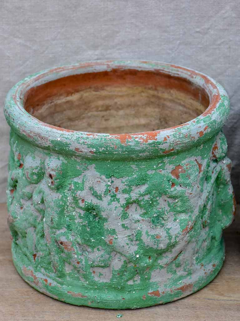 Set of three 1960's garden pots with cherubs and green patina